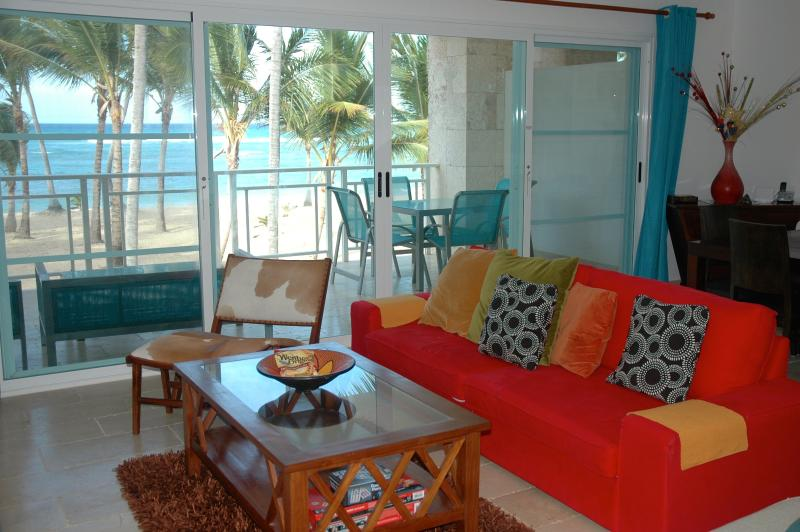 This is the expansive view overlooking the spacious terrace, beach and Ocean from the living room.