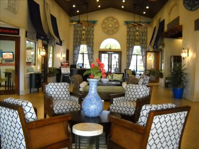 The spacious clubhouse has a concierge desk, market/gift shop, theater, gym, gameroom,  & card room.