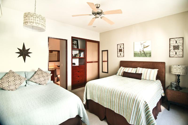 Second Bedroom With Queen Size Bed, Full Size Bed, and Ensuite Bathroom