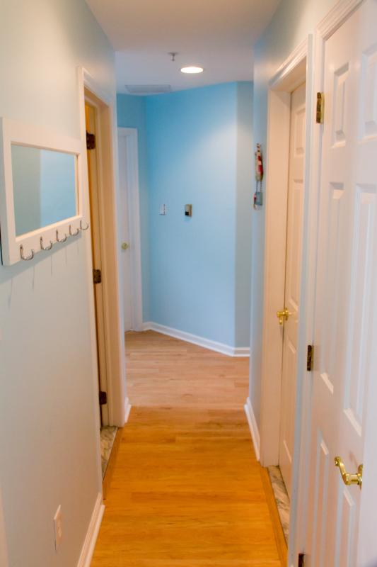 Hallway From Living Room To Bathrooms And Bedrooms