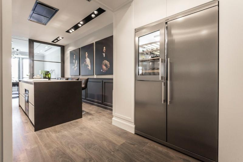 spacious kitchen with huge refrigerator with vinacoteca