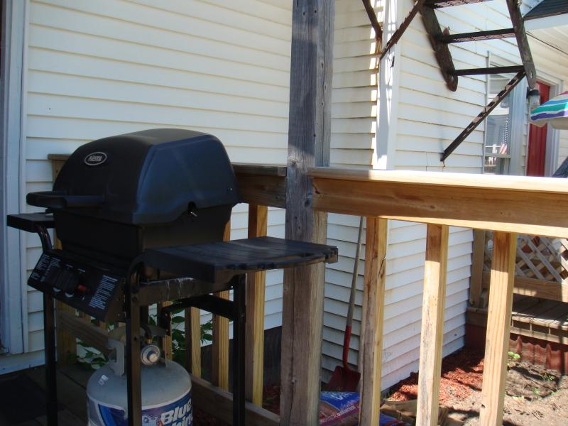 Gas grill on lower side deck.