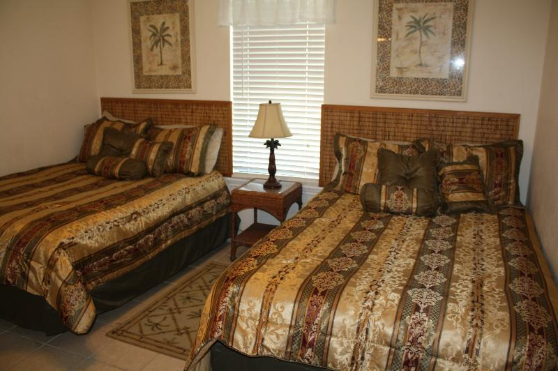 Bedroom with two full beds, TV, walk-in closet