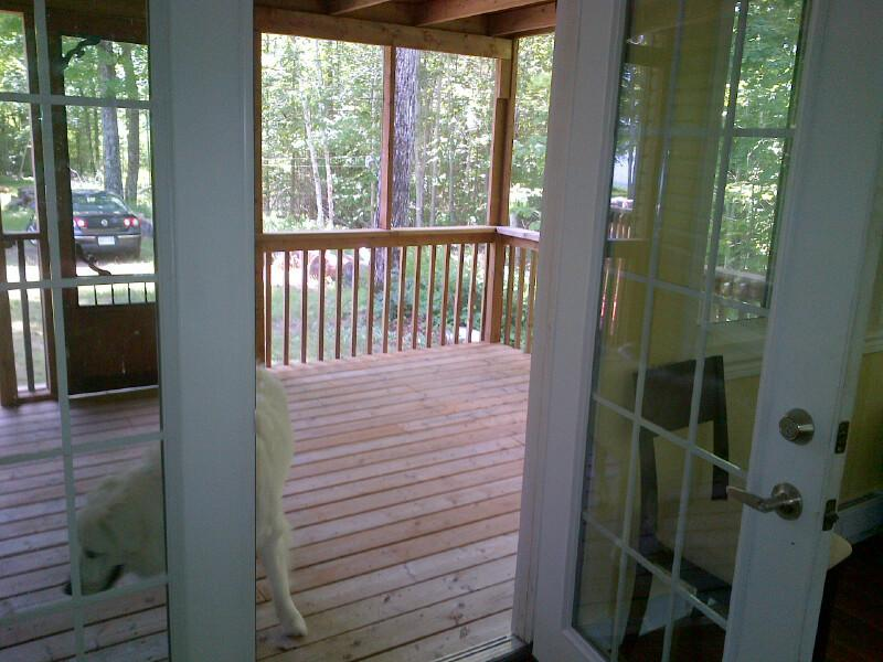 Another photo of the screen porch from the sunroom
