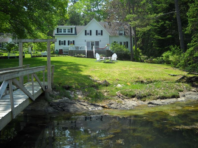 Classic saltwater farmhouse on Decker Cove on Southport Island. Beautiful private grounds with dock.