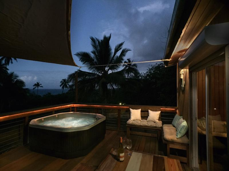 Take in the ocean view and enjoy the fresh Caribbean breeze while relaxing in the hot tub.