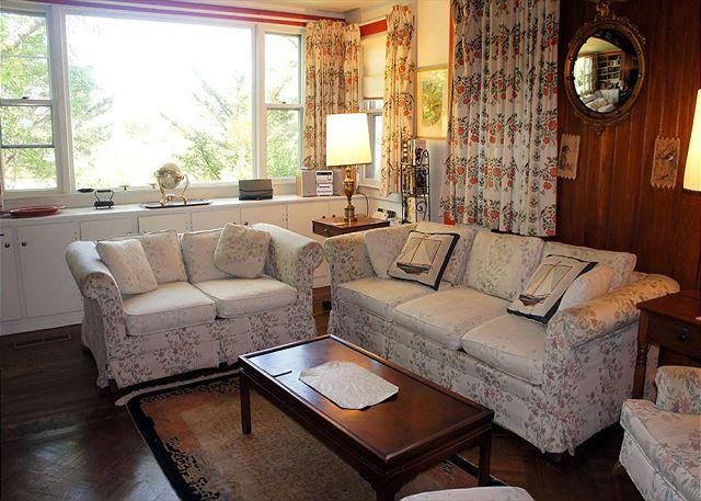 Large living room with fireplace and comfortable seating.