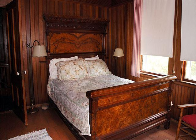 'Pink' bedroom has a double and a single bed.