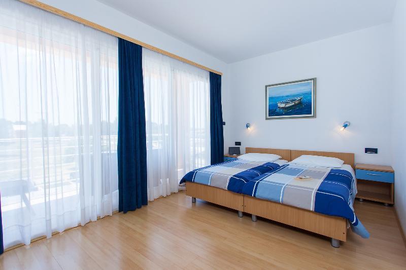 Apartamentos Villa Brioni, Fažana, Croacia - moderno y equipado, con WiFi gratuito, situado cerca de la playa