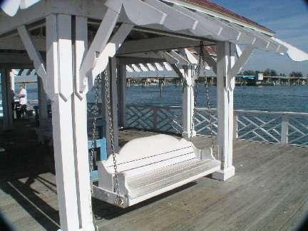 Enjoy a relaxing swing, while bird and dolphin watching, on city pier just a short walk away