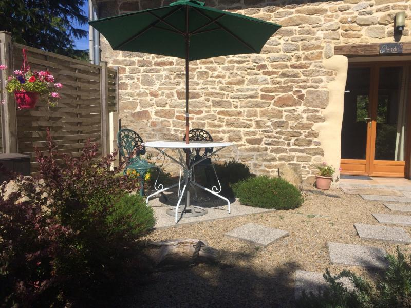 Patio seating area and entrance to the cottage