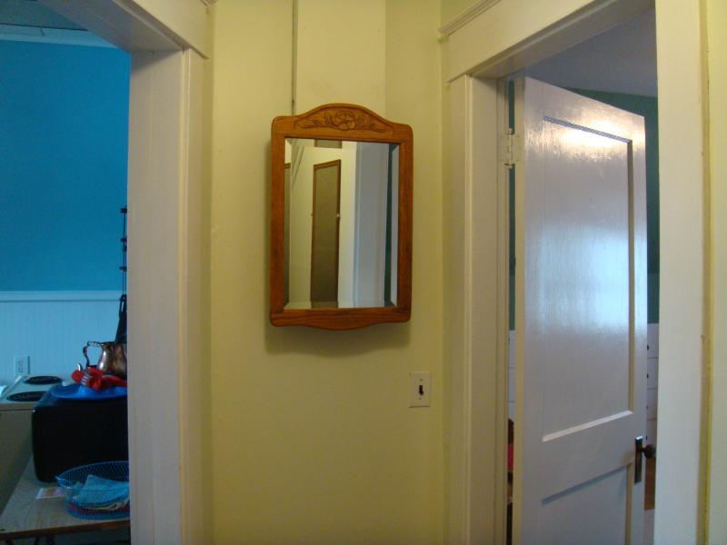 Hall between bedroom, kitchen, and bath.