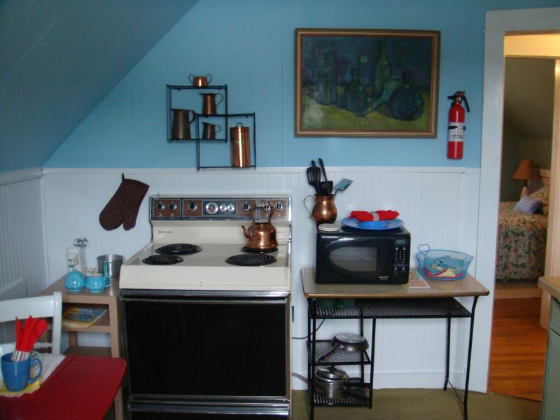 Kitchen with stove/oven and microwave.