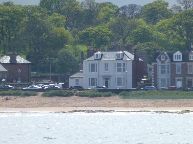 Chelmsford House - holiday apartment is ground floor left hand side - taken from the sea