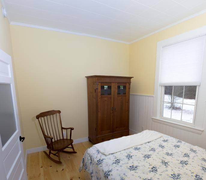 Second Bedroom with Queen Bed and Sweeping Views of Adjacent Field