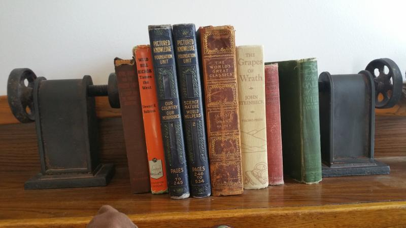 There are antique books throughout the house.