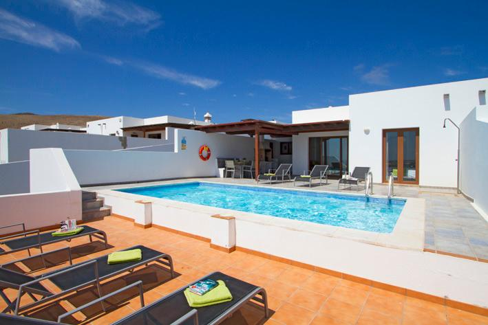 Two sun terraces surround the pool.