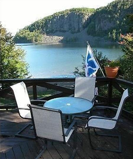 Large back deck with view of the lake and mountain