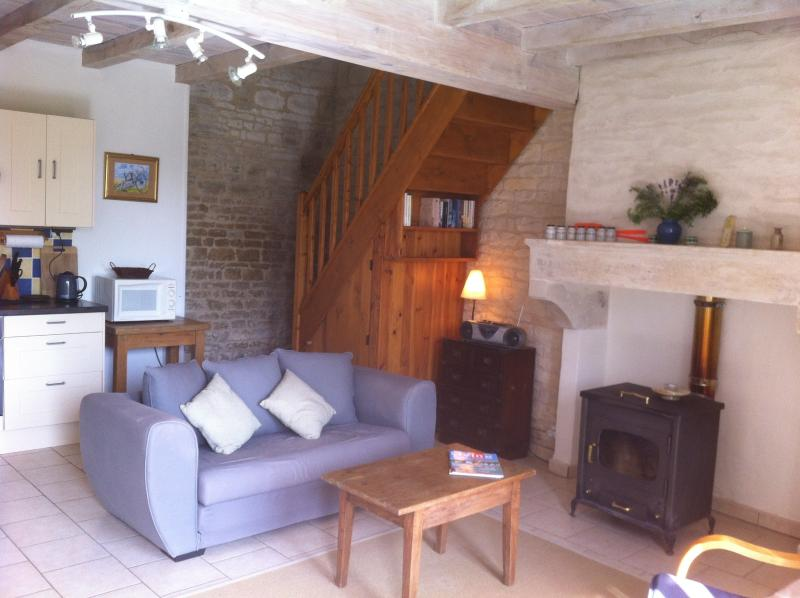 The seating area and cosy wood stove