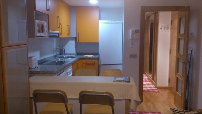 Cocina y entrada vivienda