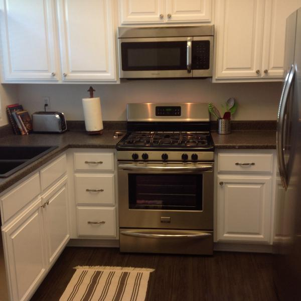 Newly remodeled Kitchen stainless steel appliances. Toaster, coffee maker, espresso maker & mixer.