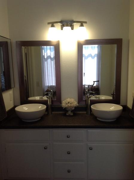 Master bath vanity with double vessel sinks, oversized enclosed tub/shower and walk in closet.