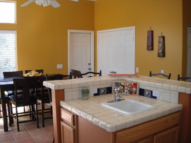 Kitchen island and dining area. Door leads to 2-car garage.