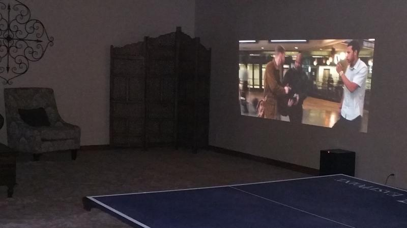 Great room with enormous projection TV