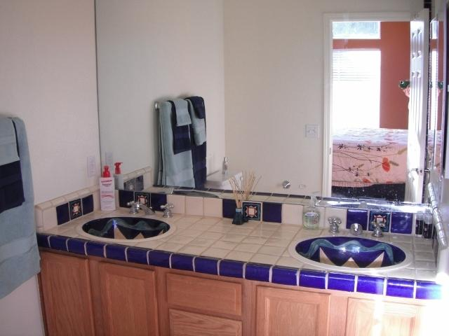 Ensuite vanity with double hand-painted Spanish sinks.