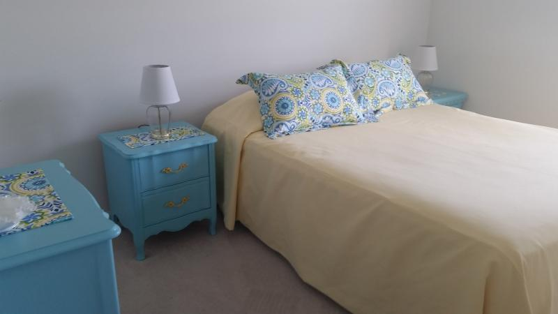 Bright yellow bedroom with Queen bed