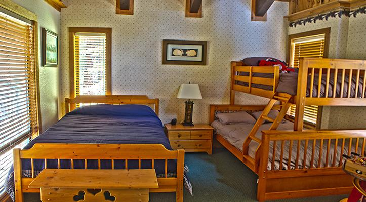 Upstairs bedroom with extra beds.