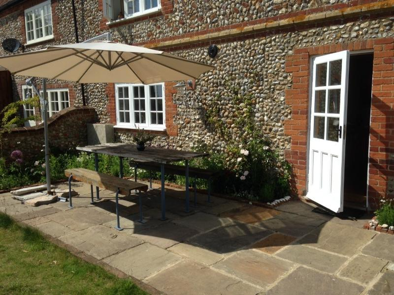 The sunny terrace at the back of the cottage