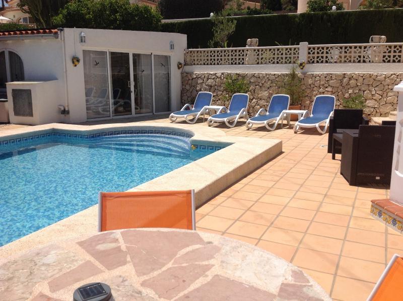 Terrace & sunbathing area looking to Summer/Pool House