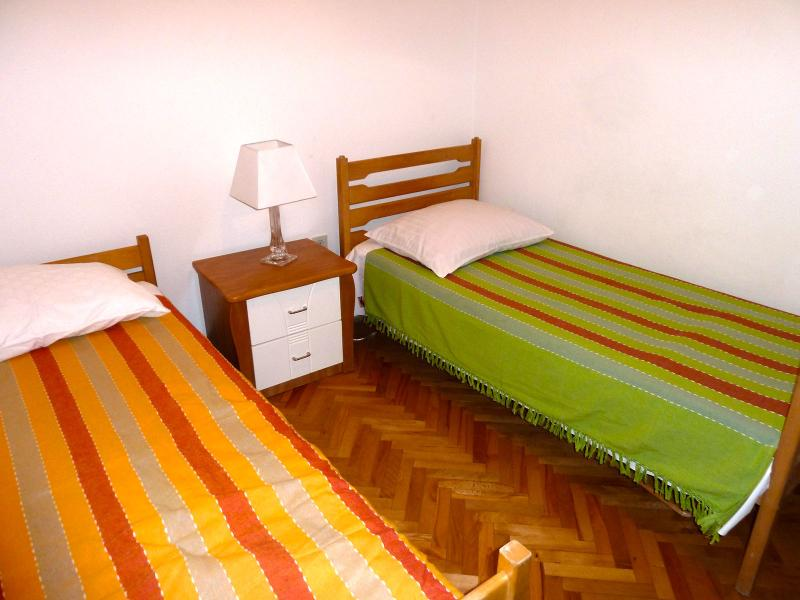 Third room; 2 single beds