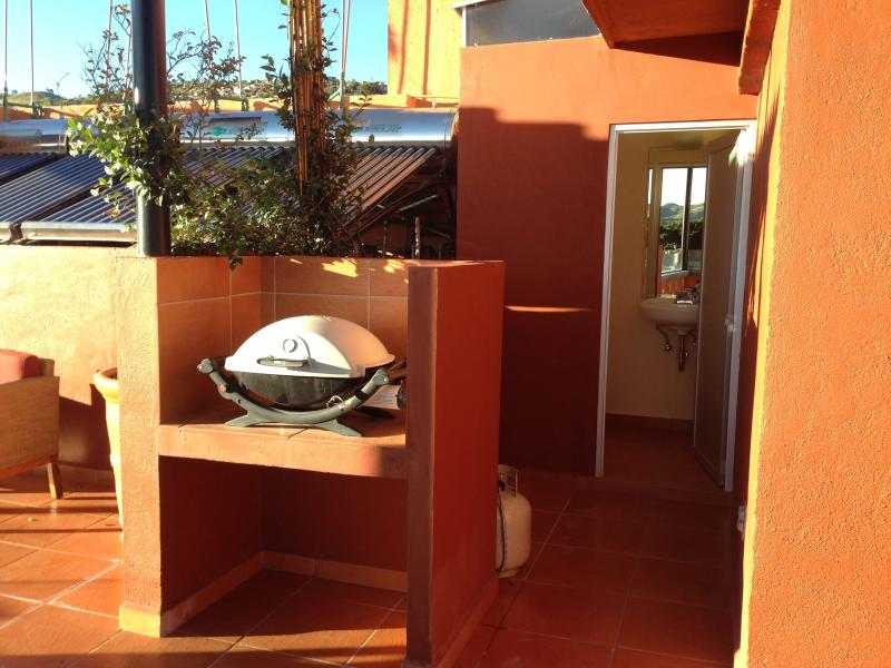 Terraza bbq and washroom.  The laundry room is on the terrazzo as well