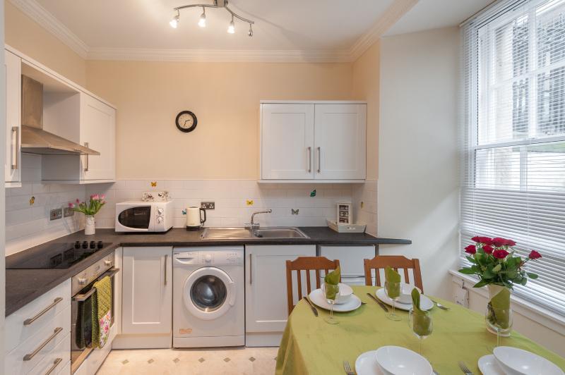 Salón apt Blair St Scott & cocina