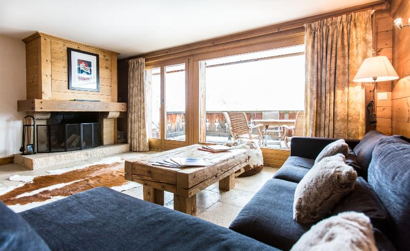 Sitting room with log fire and door to balcony