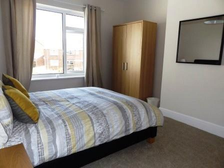 Second bedroom has a wardrobe and plenty of storage with a chest of drawers and the bedside tables.