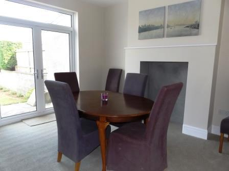 Dining Room with table to seat six and patio doors that can be opened on to the rear garden.