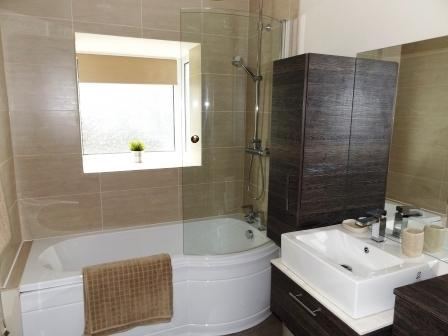Recently fitted beautiful bathroom suite which includes bath with shower over. Towels provided.
