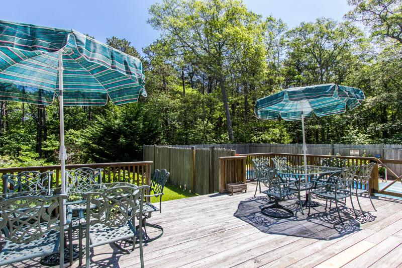 Expansive Deck Overlooks Private Yard and Pool