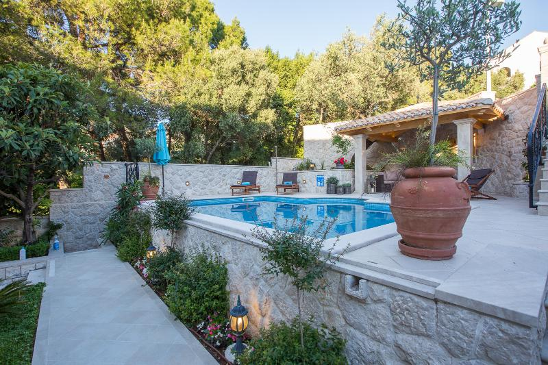 Private pool area, secluded by the surrouding garden
