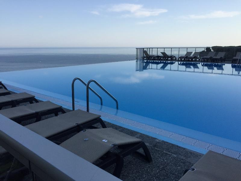 A memorable infinity pool with panoramic views over the azure Meditteranian sea
