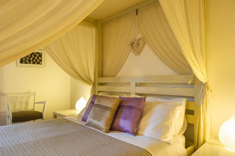 A romantic canopy bed makes your stay special!