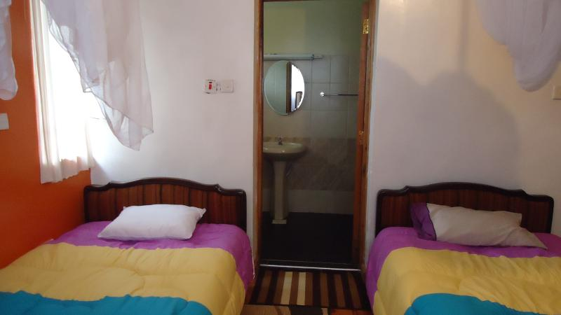 Our cosy room with twin beds very spacious. has two sets of wardrobes  for storage and is en-suite.