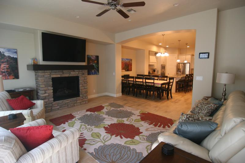 Great room- fireplace, leather power reclining couches, 65' Smart HDTV, Bluray