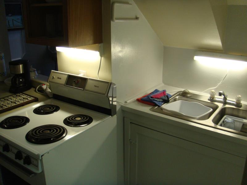 Kitchen sink and stove area.