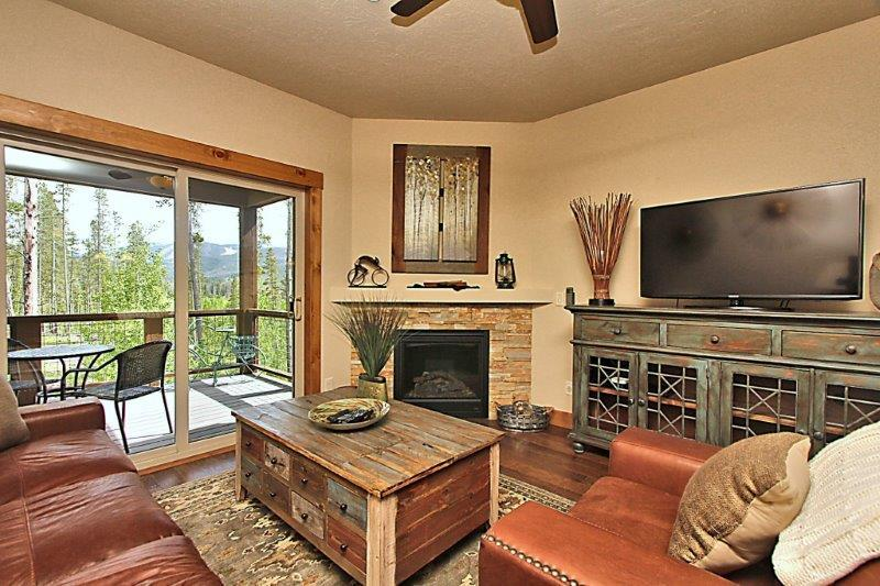 Large fireplace and flat screen TV