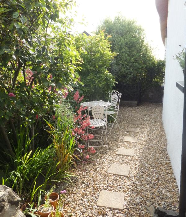 Enjoy a morning coffee or early evening drink in the sunny courtyard garden....