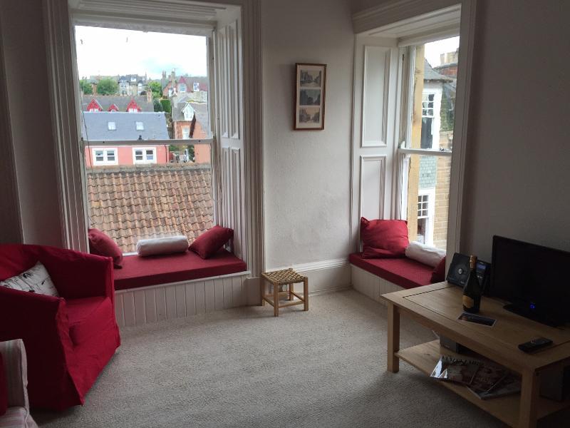 Sitting room with corner windows and window seats